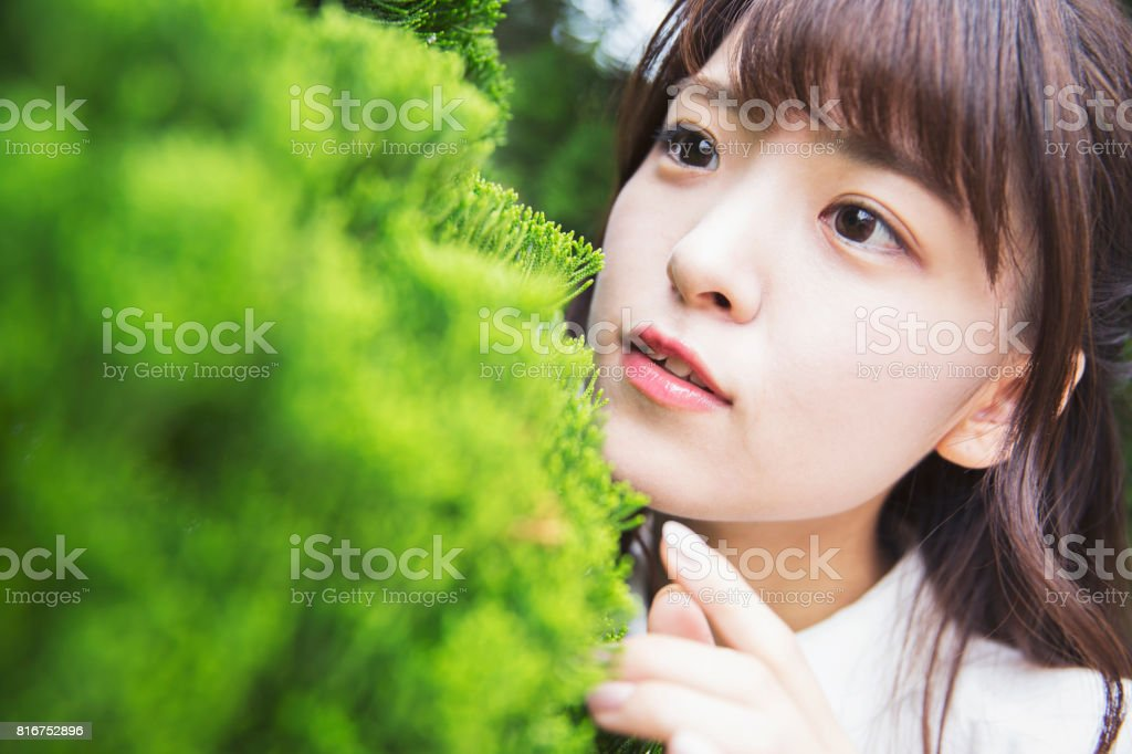 Closeup portrait of a cute and beautiful Japanese girl stock photo