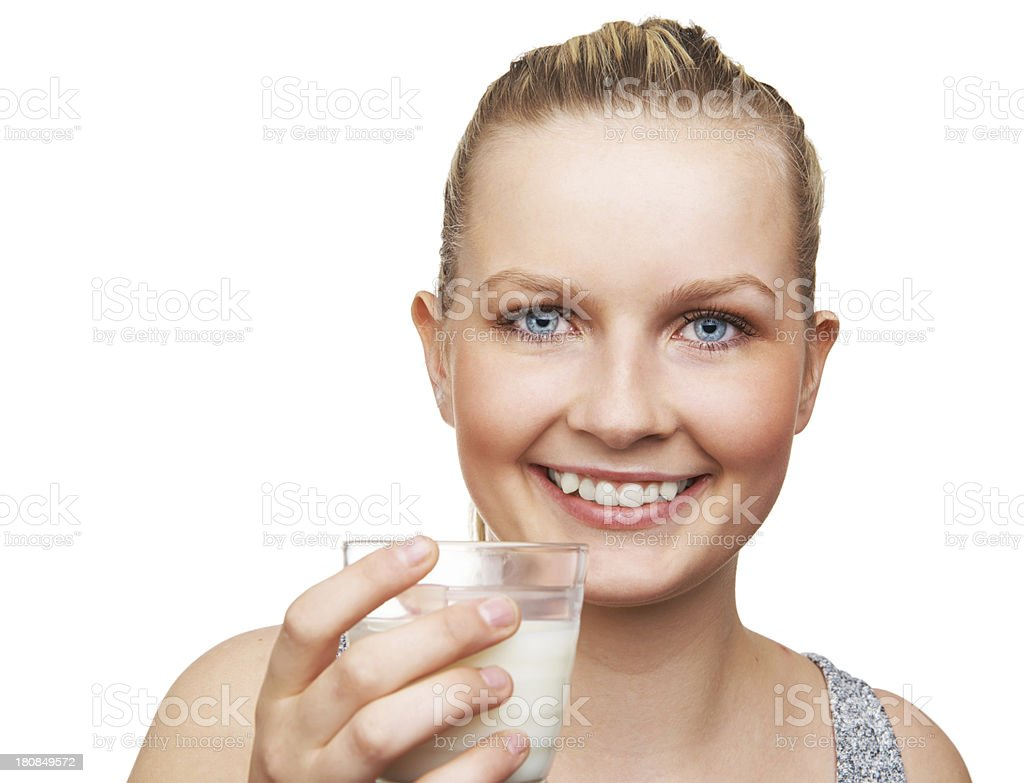 Closeup portrait of a fresh and beautiful girl with milk royalty-free stock photo
