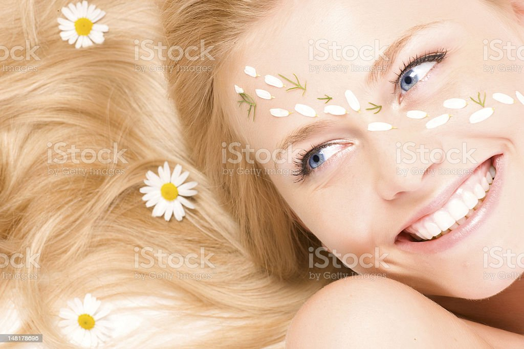 Close-up portrait of a fresh and beautiful woman with camomile. royalty-free stock photo