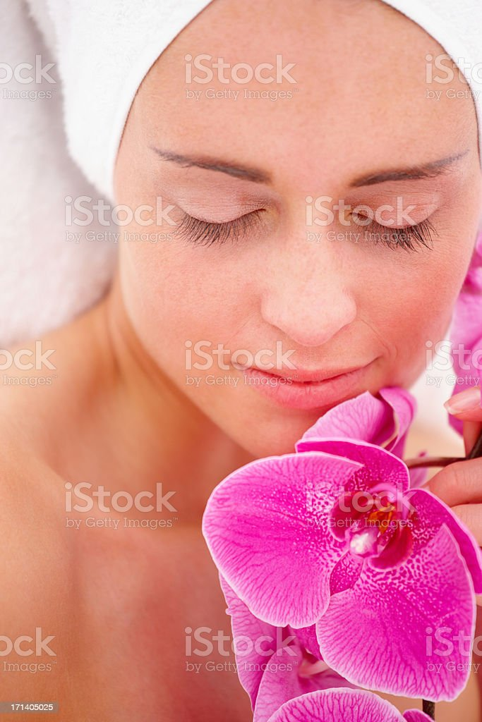 Closeup portrait of a fresh young beautiful girl holding pink flowers royalty-free stock photo