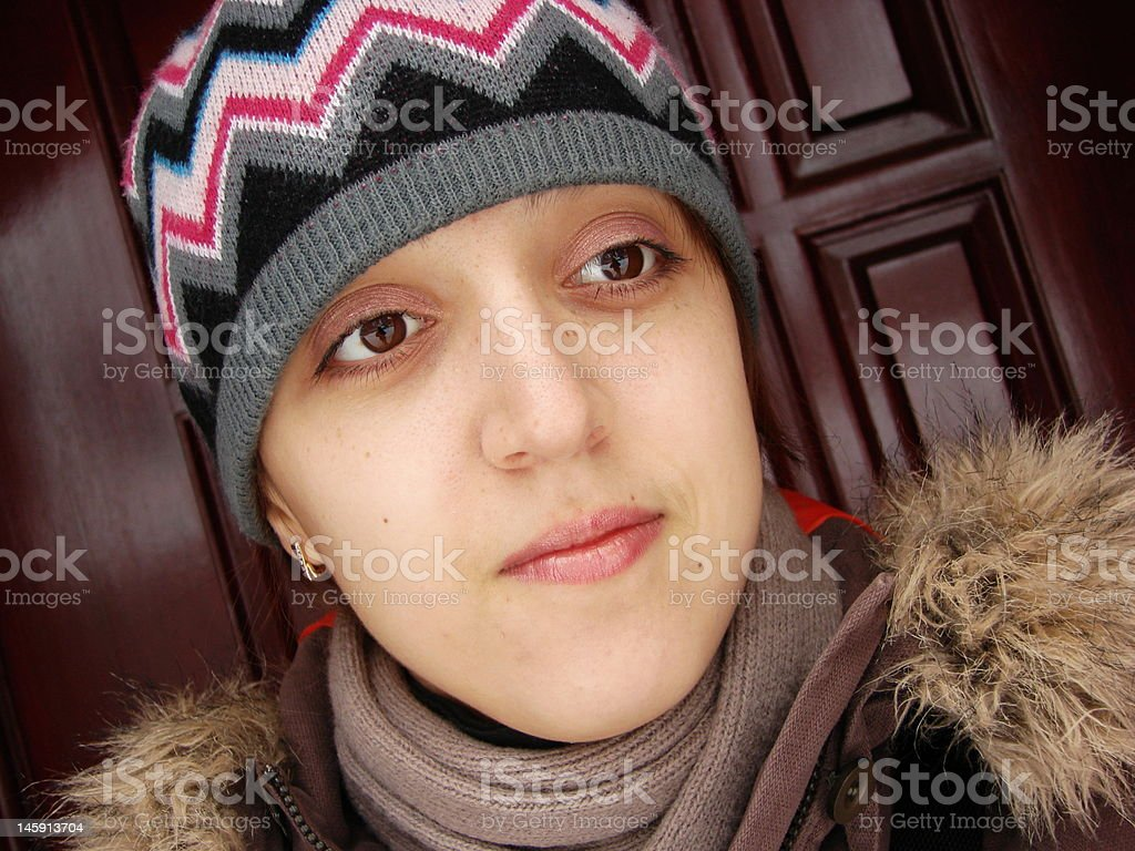 Closeup portrait of a girl in cap royalty-free stock photo