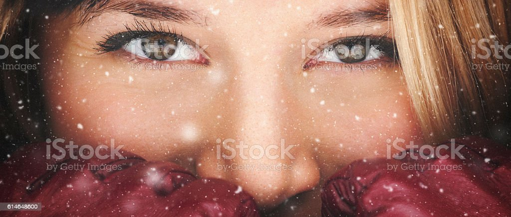Closeup portrait of a girl while snowing stock photo