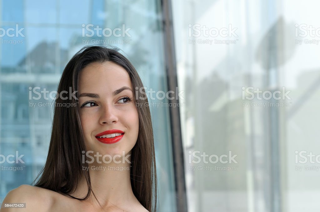 Close-up portrait of a girl with bared shoulders stock photo