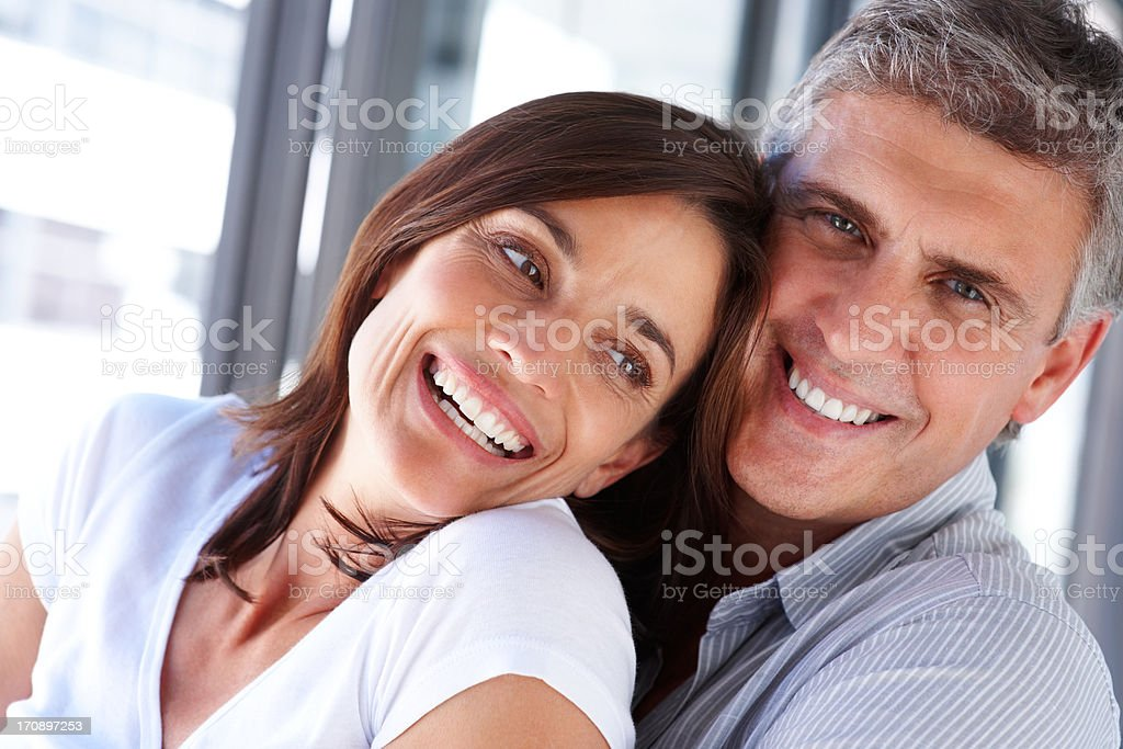 Closeup portrait of a happy cheerful couple laughing together royalty-free stock photo