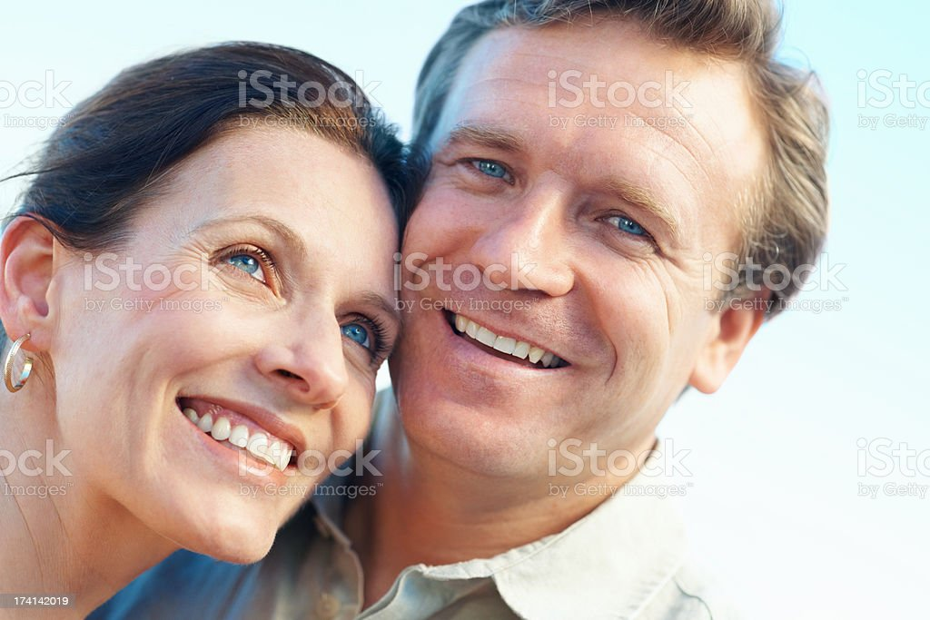 Closeup portrait of a mature couple smiling together stock photo