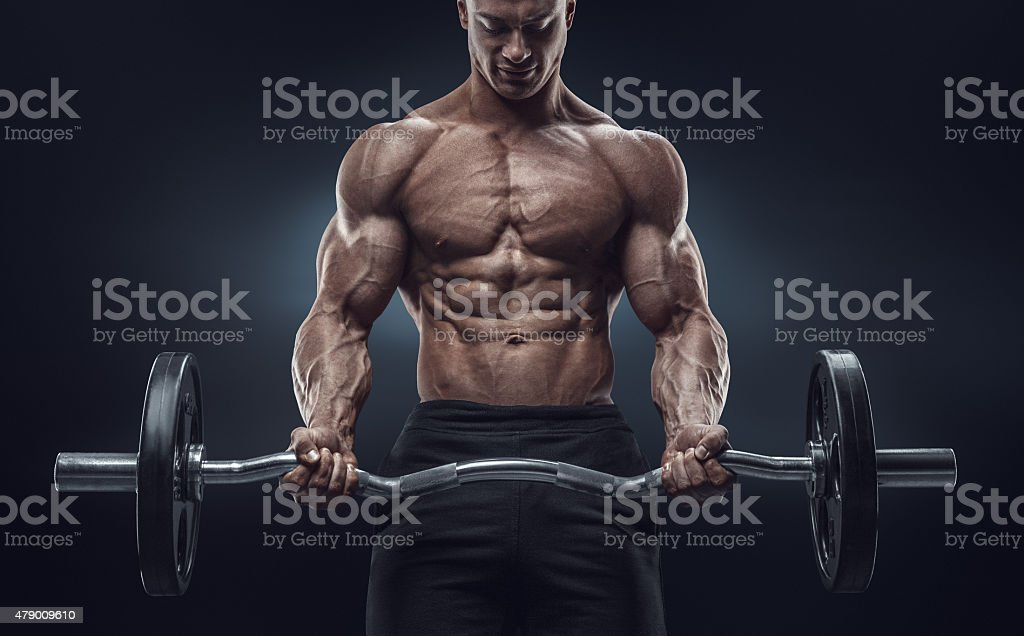 Closeup portrait of a muscular man workout with barbell stock photo