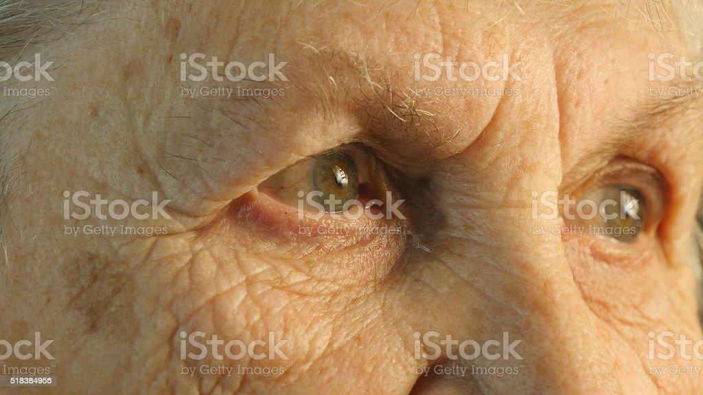 Close-up portrait of a old woman's gaze stock photo