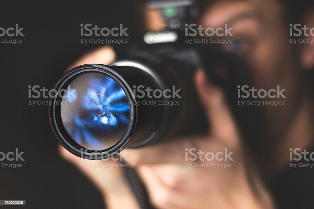 Close-up portrait of a photographer at work stock photo