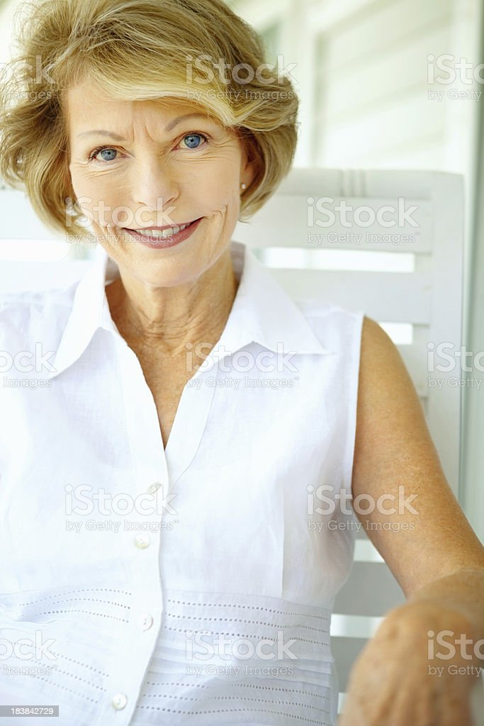 Closeup portrait of a relaxed retired woman royalty-free stock photo