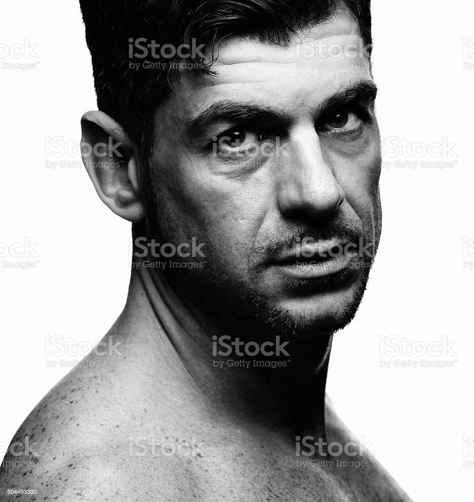Close-up portrait of a serious looking naked man stock photo