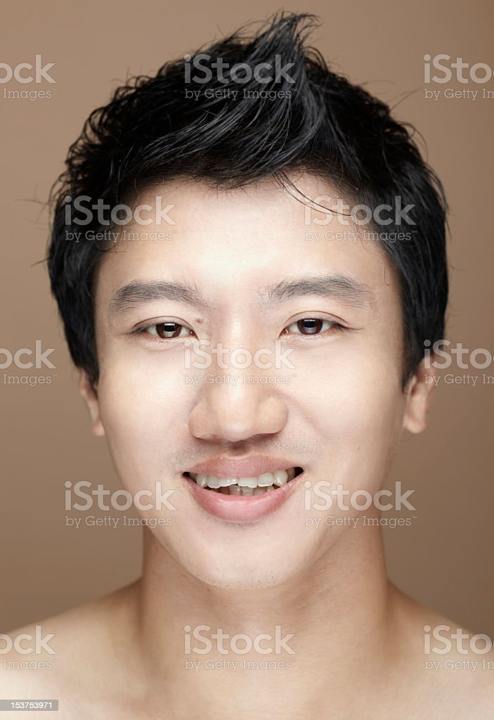 Close-up portrait of a smiling Asian male face royalty-free stock photo