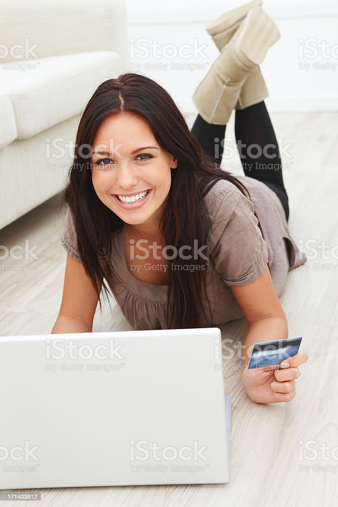 Closeup portrait of a smiling beautiful young lady shopping on internet royalty-free stock photo