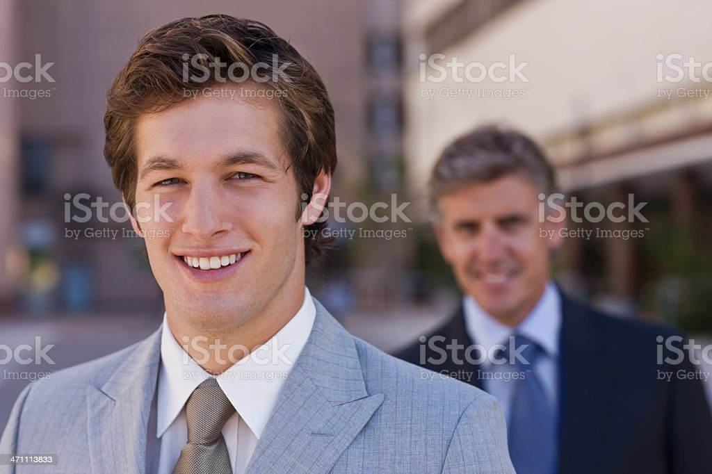 Close-up portrait of a smiling handsome young businessman royalty-free stock photo