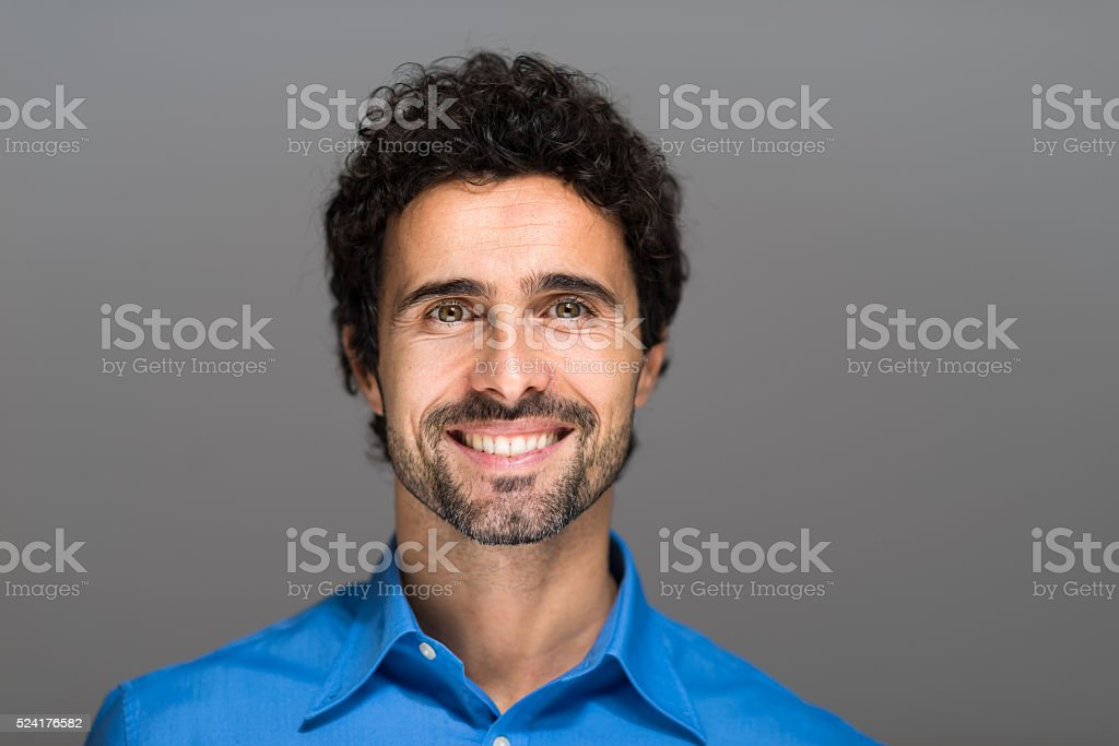 Closeup portrait of a smiling man. stock photo