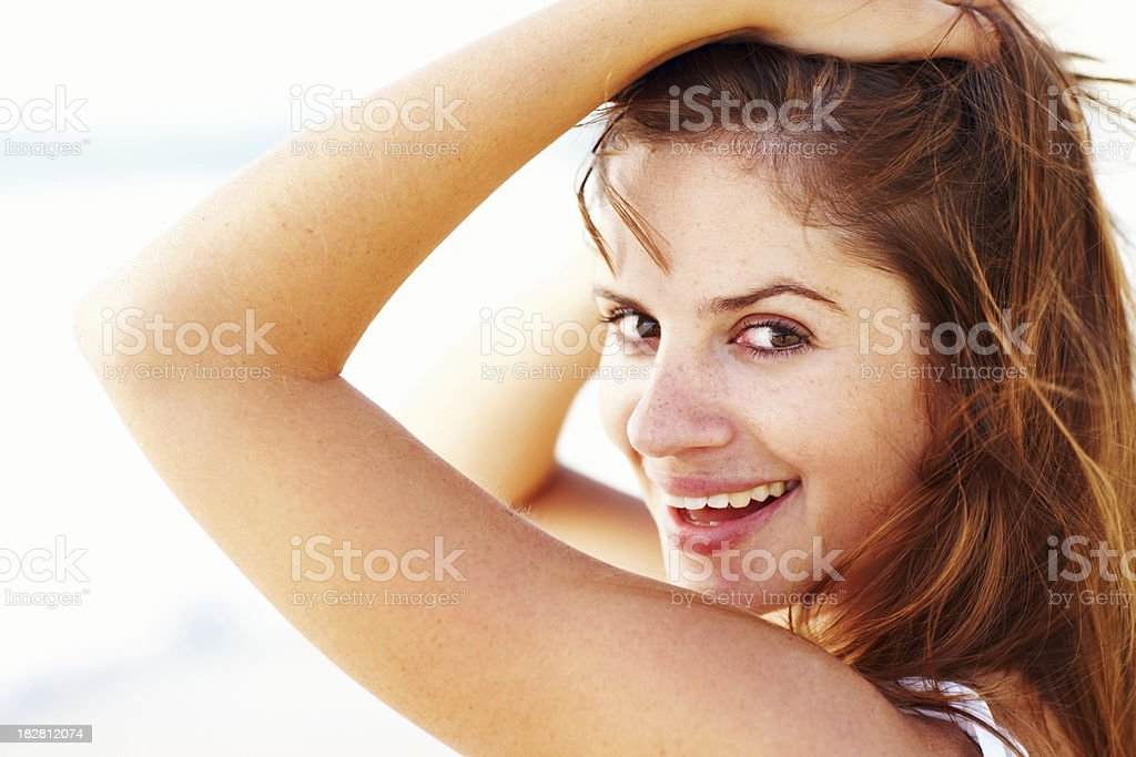 Close-up portrait of a smiling young lady royalty-free stock photo
