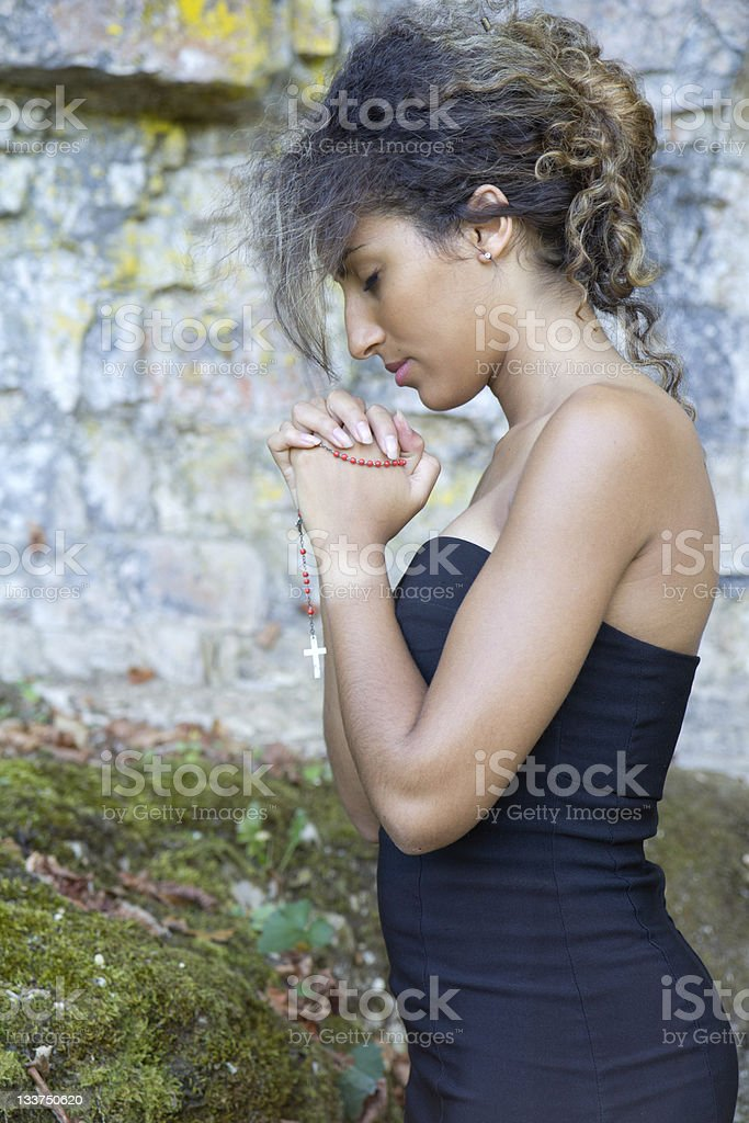 Close-up portrait of a woman who is praying. stock photo