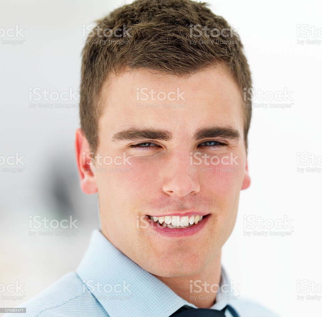 Closeup portrait of a young happy business man isolated on white background royalty-free stock photo