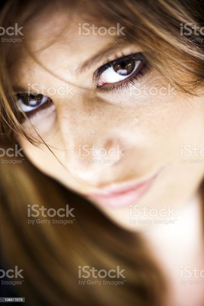Close-up portrait of a young woman looking at the camera royalty-free stock photo