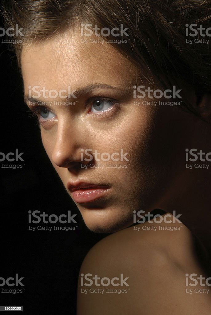 Close-up portrait of a young woman with blue eyes royalty-free stock photo