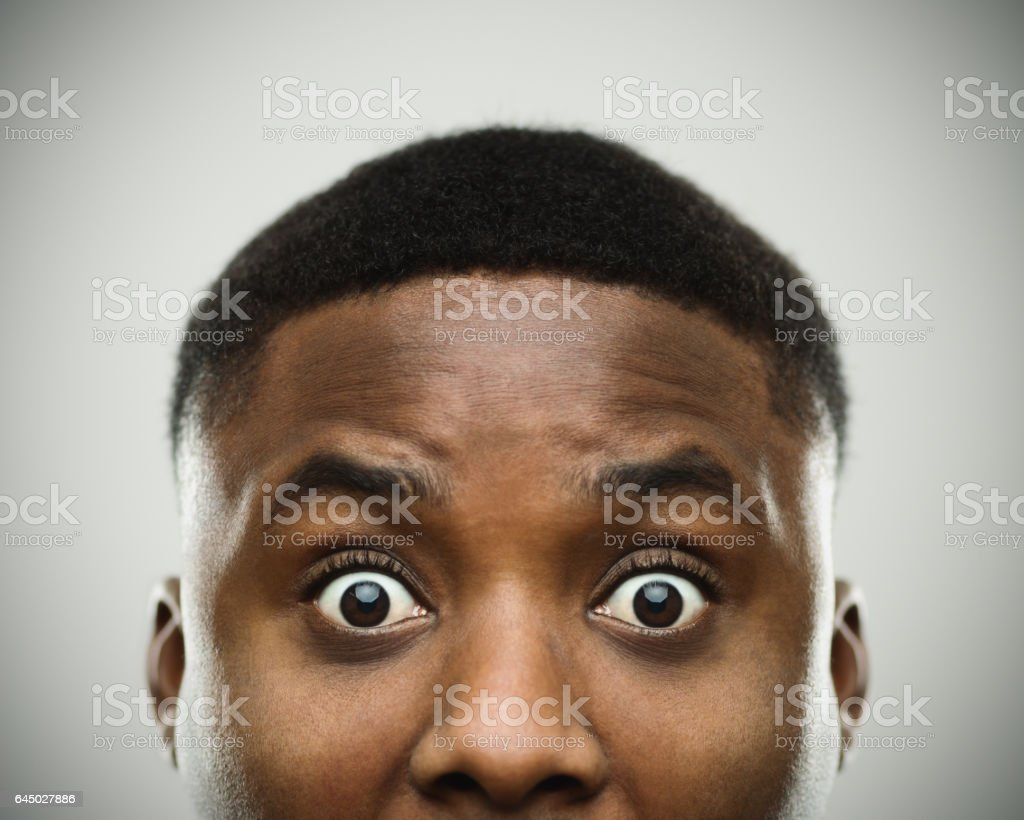 Close-up portrait of african man shocked stock photo
