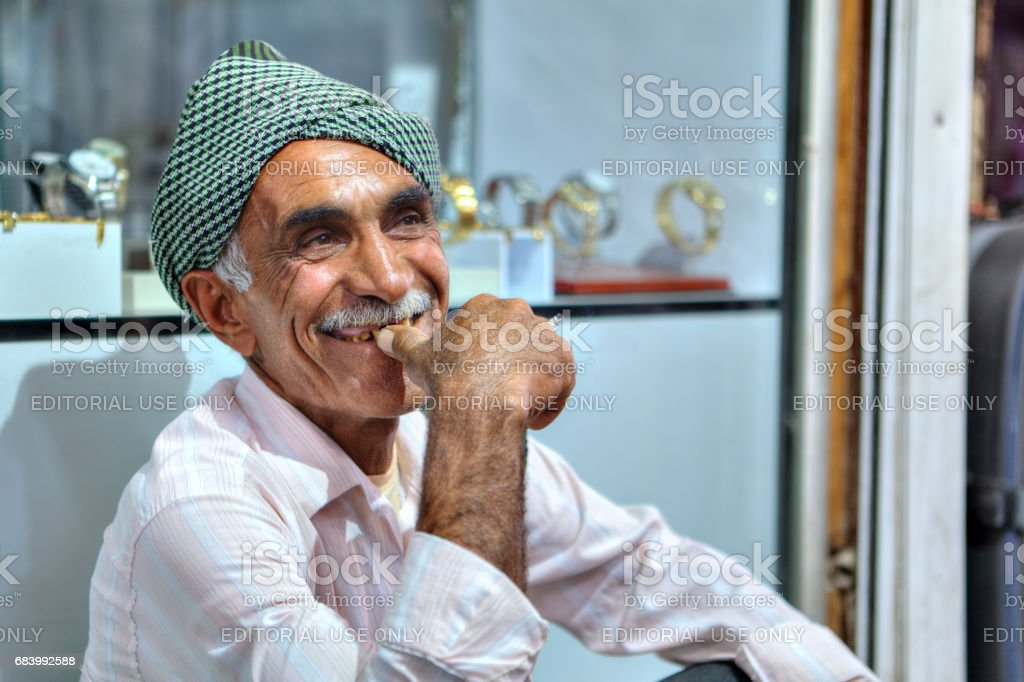 Close-up portrait of an elderly smiling Iranian in a headscarf. stock photo