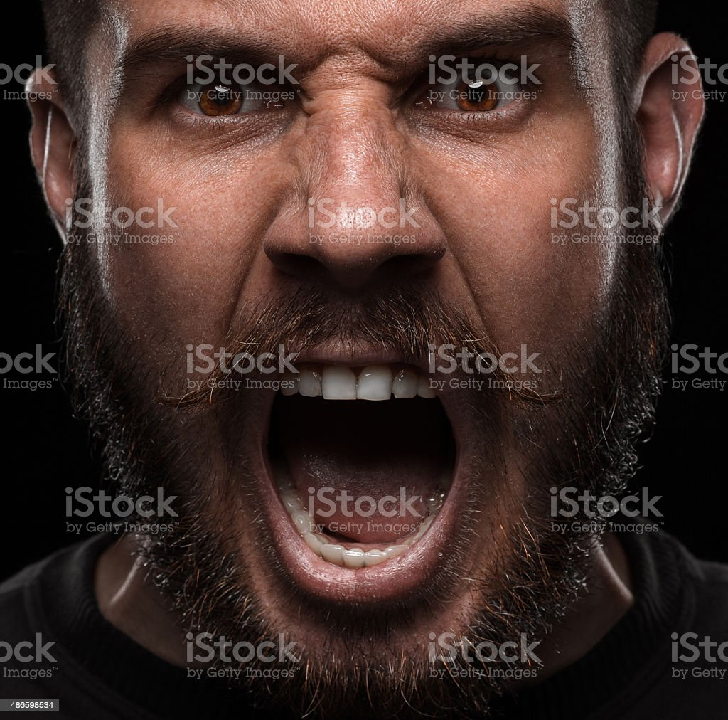 Close-up portrait of angry man stock photo