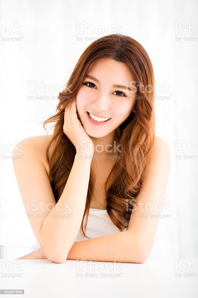 Closeup portrait of  attractive young woman smiling stock photo