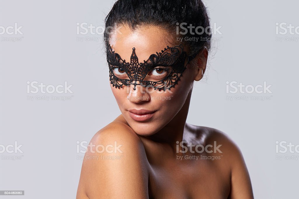 Closeup portrait of beautiful mixed race with black lace mask stock photo