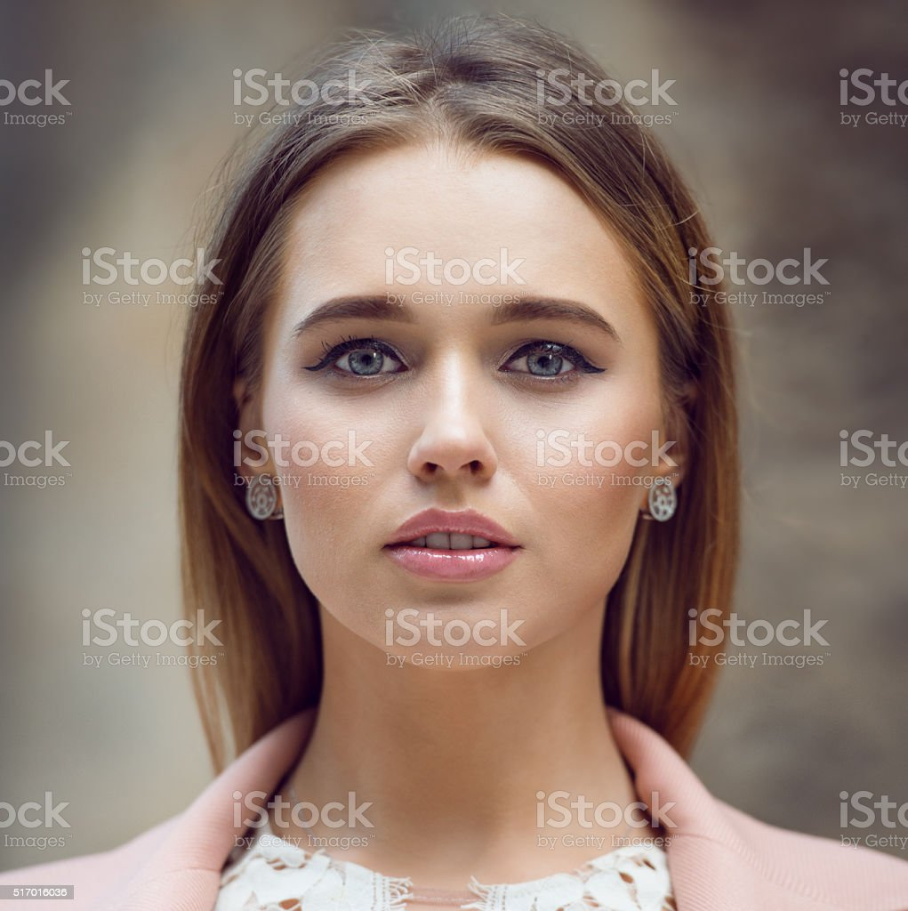 Close-up portrait of beautiful natural young woman face stock photo