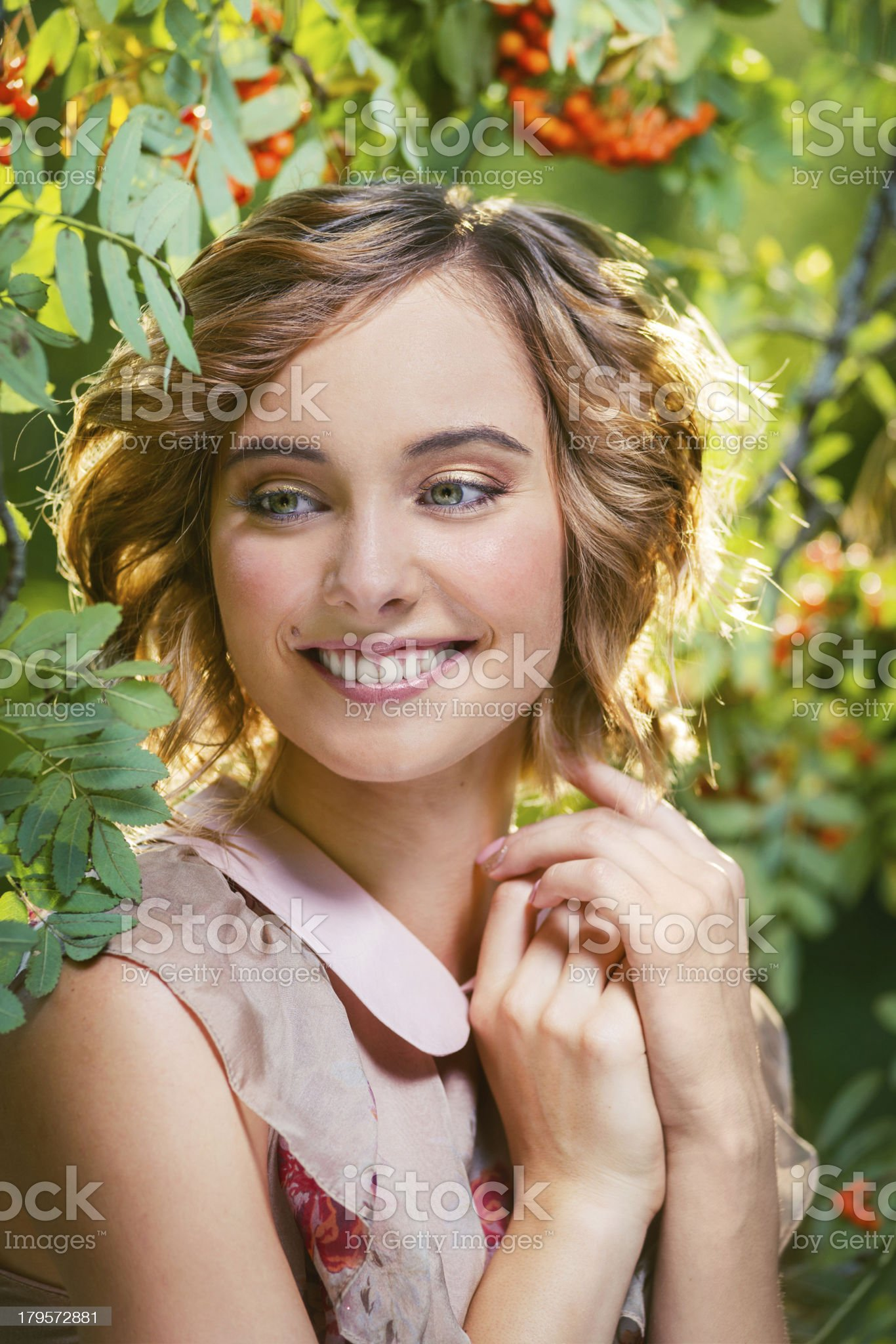 Close-up portrait of beautiful russian woman wearing pink dress royalty-free stock photo