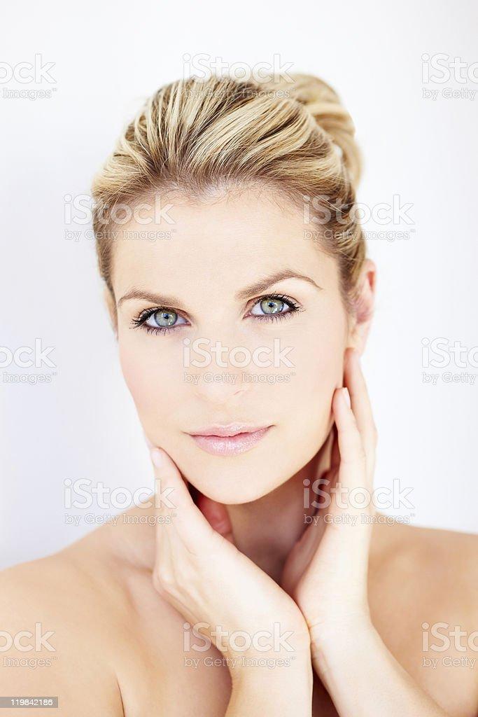 close-up portrait of beautiful woman posing stock photo