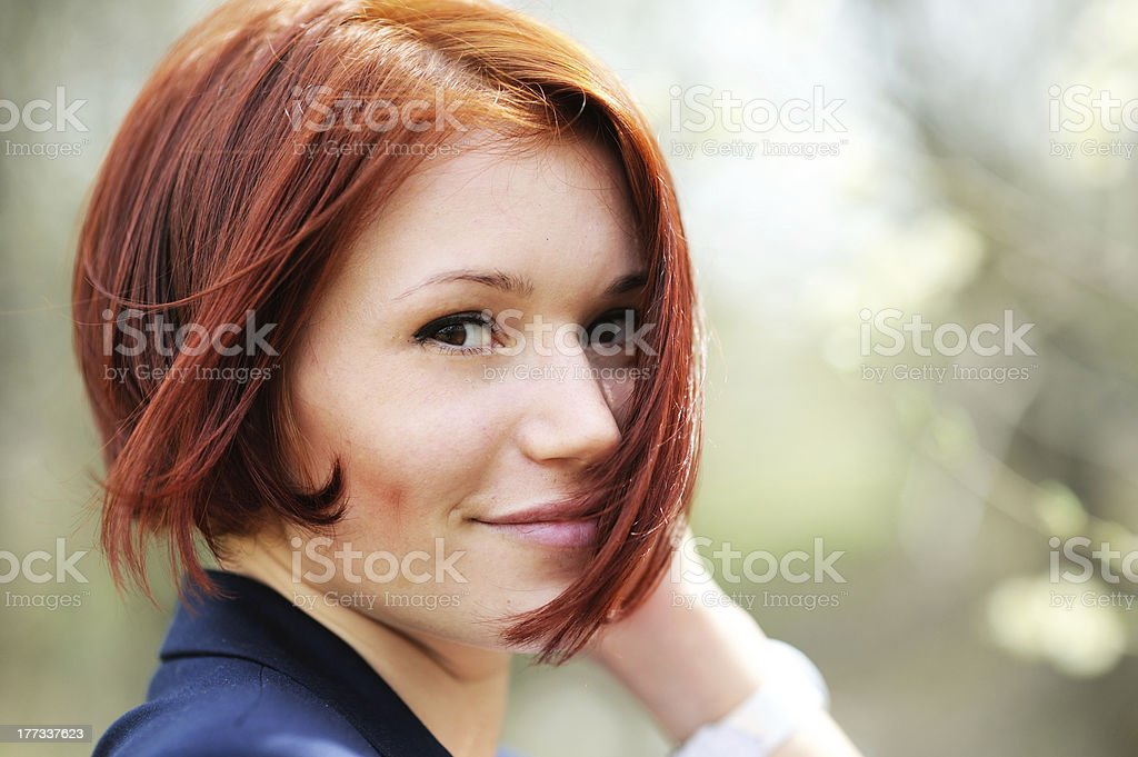 Closeup portrait of beautiful woman with red hair stock photo