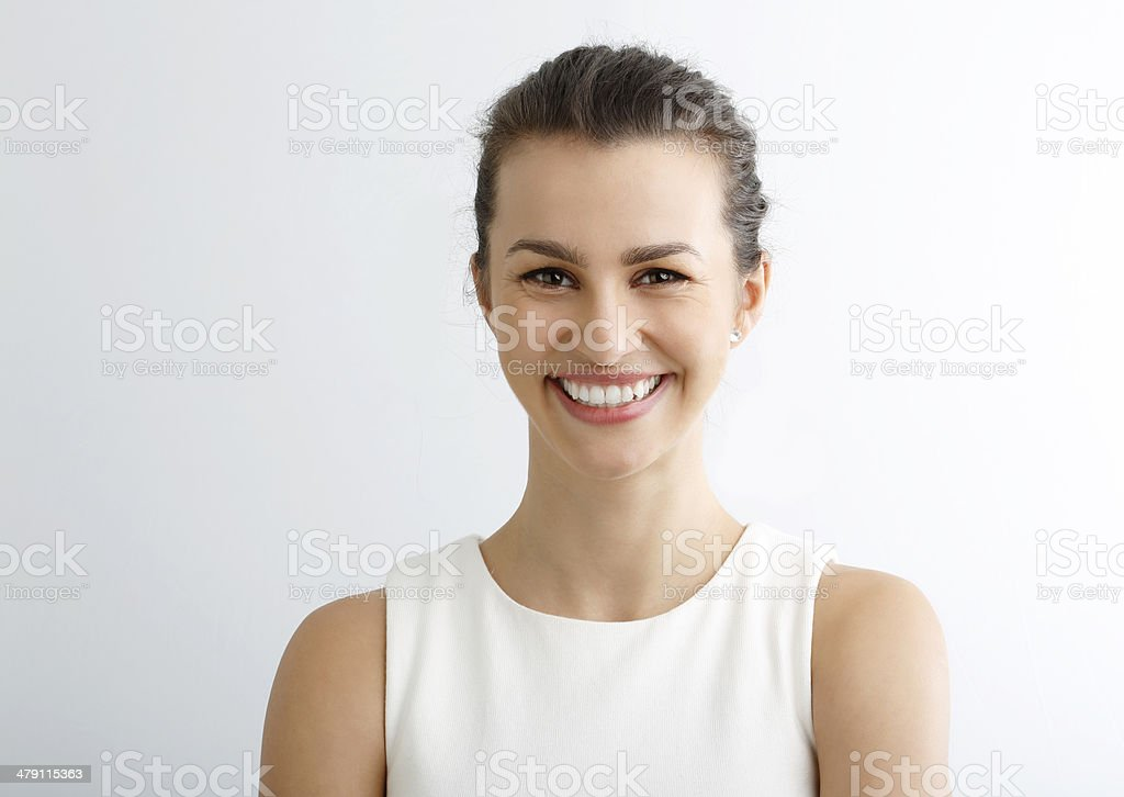 Close-up portrait of beautiful young woman looking at camera stock photo