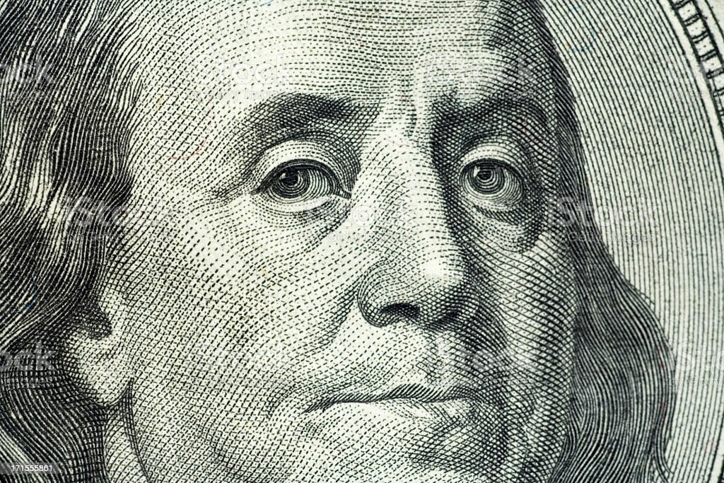 Closeup portrait of Benjamin Franklin on hundred dollar bill stock photo