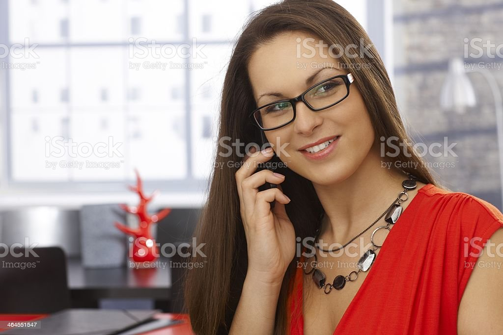 Closeup portrait of businesswoman on mobile royalty-free stock photo