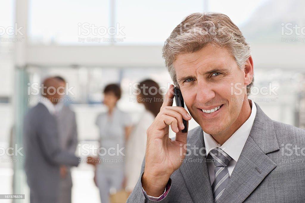 Closeup portrait of confident mature businessman talking royalty-free stock photo