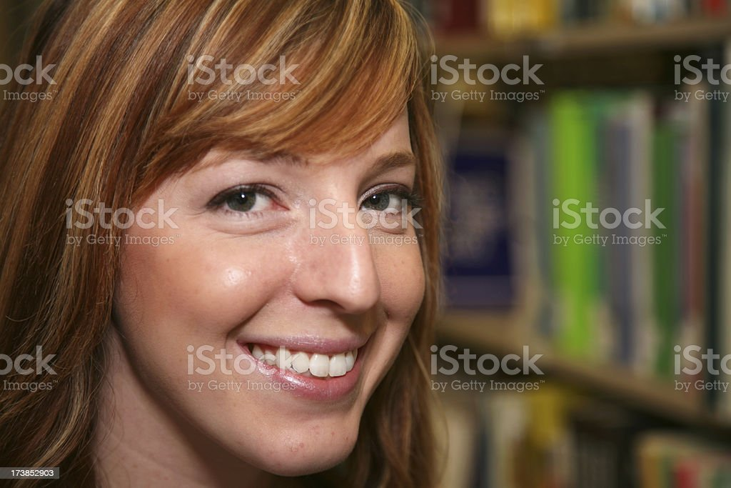 Closeup Portrait of Cute Female College Girl in the Library royalty-free stock photo