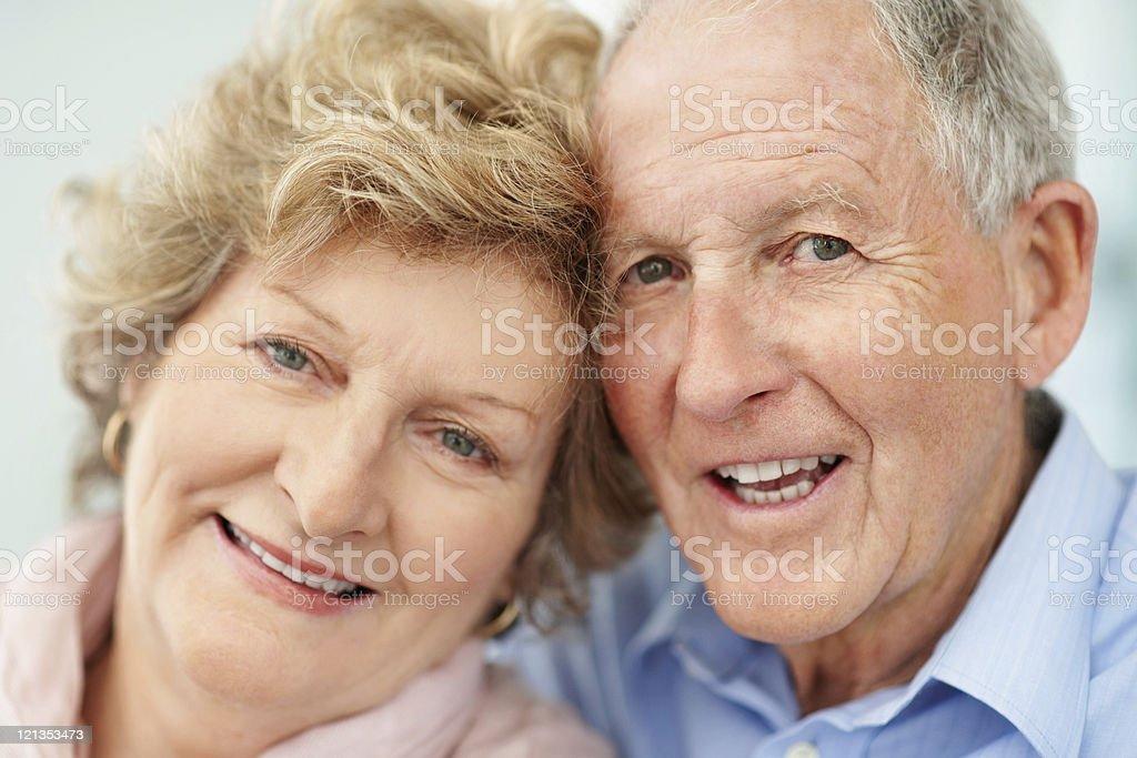 Closeup portrait of elderly couple looking happy stock photo