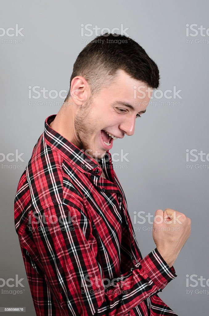 Closeup portrait of excited, energetic, happy student, man winning stock photo