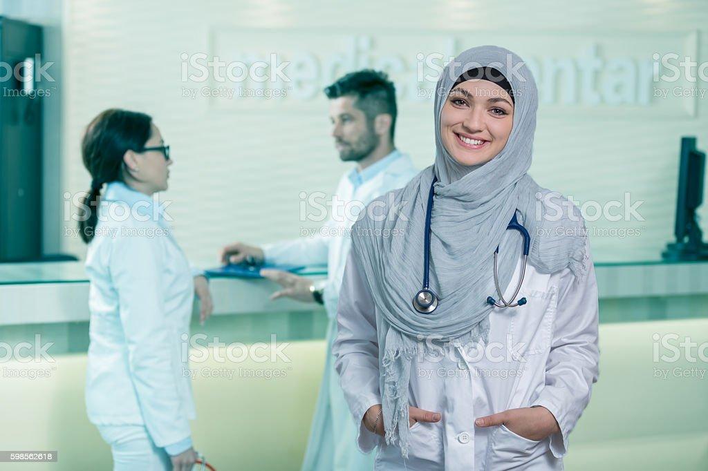 Closeup portrait of friendly, smiling confident muslim female doctor. stock photo
