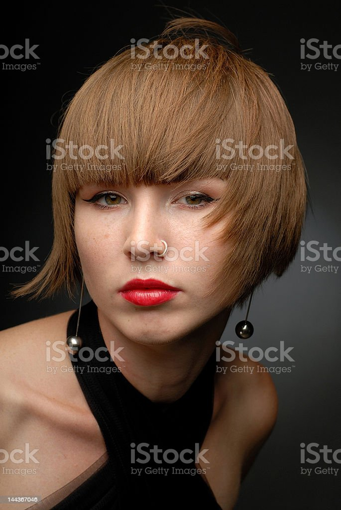 Close-up portrait of girl both shoulders seen wind blown hair royalty-free stock photo