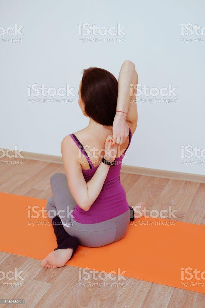 Closeup portrait of girl in classroom yoga practice. Exercises lock...