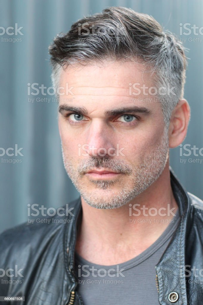 Close-up portrait of gray haired bearded male stock photo