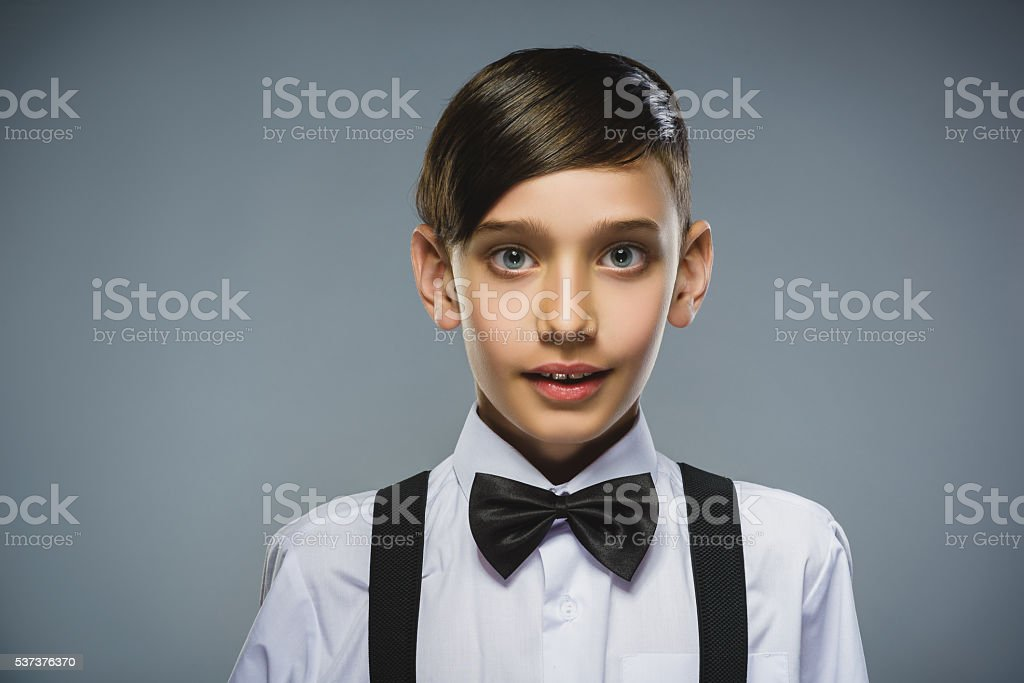 Closeup Portrait of happy boy going surprise isolated on gray stock photo