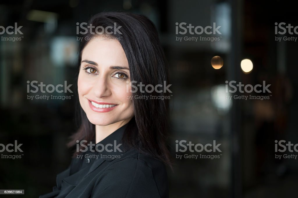 Close-up portrait of happy businesswoman in office stock photo
