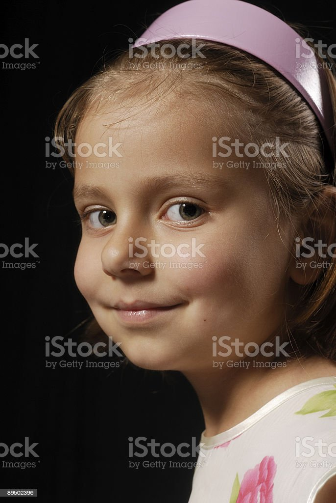 Close-up portrait of little girl with a pink hairban royalty-free stock photo