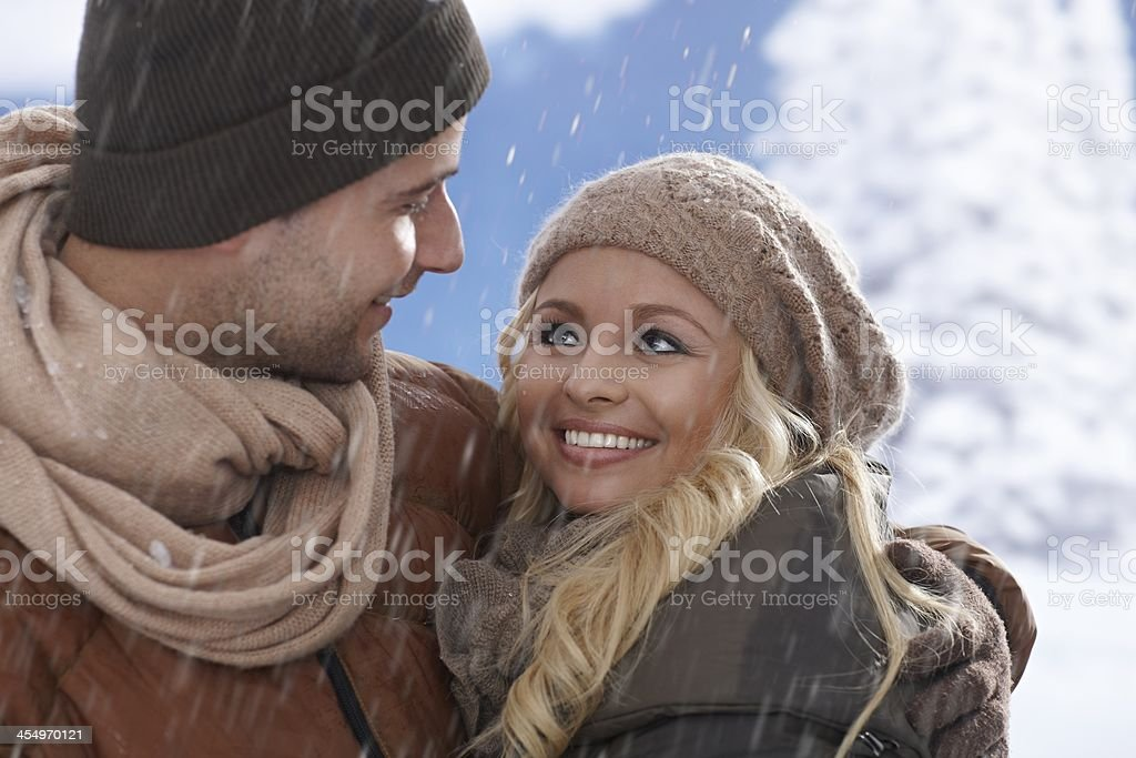Closeup portrait of loving couple in snowfall stock photo