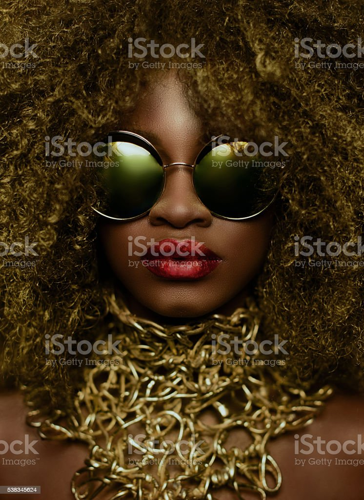 Close-up portrait of magic golden african american female model stock photo