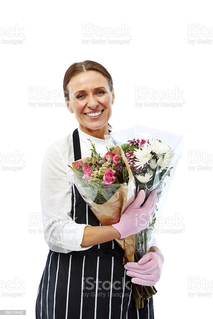 Closeup portrait of mature florist holding bouquet stock photo