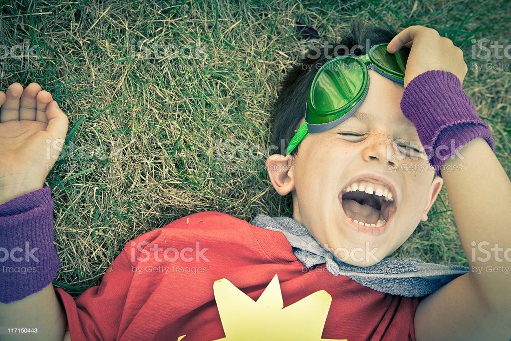 Closeup Portrait of Playful Laughing Costumed Superhero Boy Having Fun royalty-free stock photo